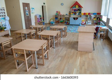 Kyiv, Ukraine - October 14, 2019: Interior of a spacious kindergarten room with small children tables and chairs.