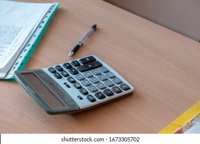 Kyiv, Ukraine - October 14, 2019: Calculator, pen and documents on office work desk.