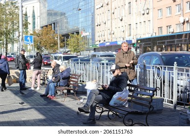 Kyiv, Ukraine - October 19 2021: people sitting on benches on a busy street