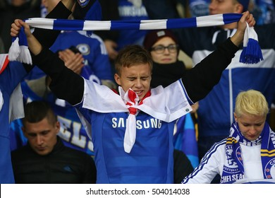 KYIV, UKRAINE - OCTOBER 20, 2015: disappointed crying Chelsea fan portrait with a scarf, UEFA Chamions League Group Stage match between Dynamo Kyiv and Chelsea