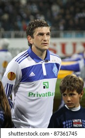 KYIV, UKRAINE - OCTOBER 20: Goran Popov of Dynamo Kyiv and unidentified young child during UEFA Europa league game against Besiktas on October 20, 2011 in Kyiv, Ukraine
