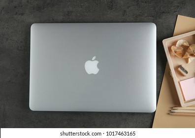 KYIV, UKRAINE - OCTOBER 23, 2017: Flat lay composition with Apple MacBook Air Silver on gray background