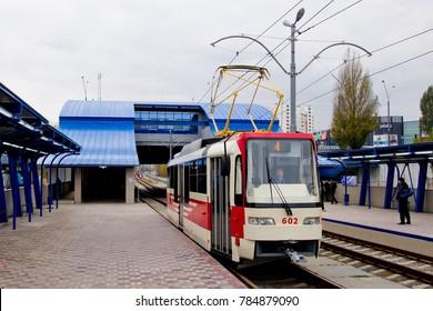 KYIV / UKRAINE – OCTOBER 25, 2012: Red tram on Oleksandra Saburova station, Light Rail tram line, Troieshchyna neighborhood.