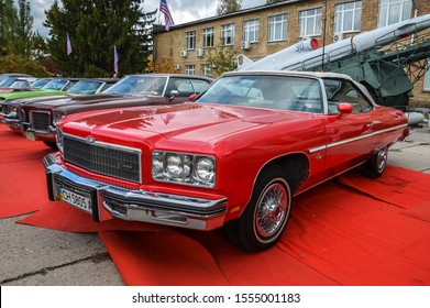 KYIV, UKRAINE OCTOBER 6 2019: old car land festival. One of the famous American cars of the 60-70s full-size Chevrolet Impala 1973 on the exhibition of retro cars