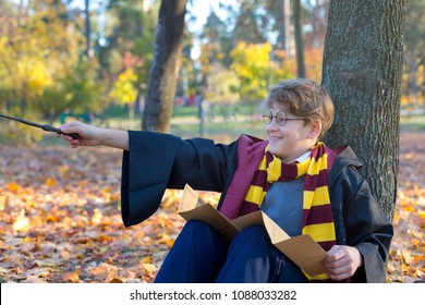 KYIV, UKRAINE - OCTOBER 8, 2017: cute pretty boy in costume of Harry Potter play as  a magician. Cosplay, Halloween costume
