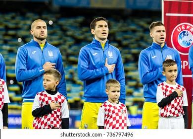 Kyiv, Ukraine - October 9, 2017: Yaroslav Rakitskiy, Taras Stepanenko and Mykola Matvienko singing national anthem. FIFA World Cup 2018 Qualifying round Ukraine - Croatia