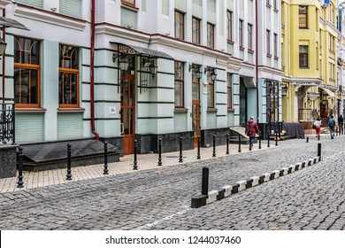KYIV, UKRAINE - OKTOBER 28, 2018: Vozdvizhenka - residential area built in early 2000s in heart of historical Kyiv. Shops, cafes, galleries at first floors of houses transmit spirit of old Podil.
