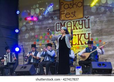 "Kyiv. Ukraine. Pasca festival. May 07, 2016. The inscription on the Ukrainian language ""taste the cake"". Orchestra of the Crimean Tatars."