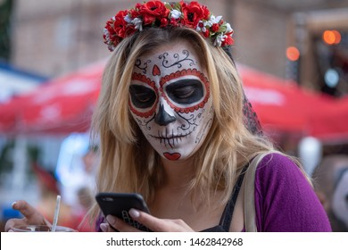 Kyiv, Ukraine, Santa Muerte Carnival, 20.07.2019. Dia de los Muertos, Day of the Dead. halloween. Portrait of young girl with skullmake-up on her face