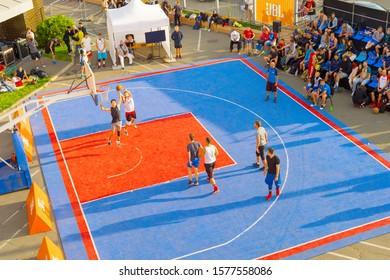 KYIV, UKRAINE - SEPT 14, 2109: Men play basketball on a street. Street ball championship. Aerial view