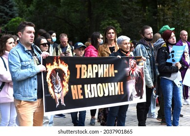 Kyiv, Ukraine, Sept.5. 2021: All-Ukrainian March for Animal Rights 2021. Protesters hold banner Animals aren't clowns. Forbid animals in circuses.