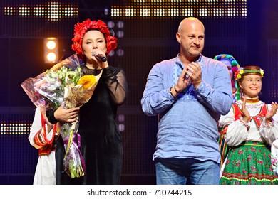 KYIV, UKRAINE - SEPTEMBER 1, 2017: Roman Nedzeljsjkyj (R) and Olena Mozghova (L) during concert-memory of Mykola Mozghovyi