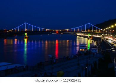 Kyiv, Ukraine - September 1, 2018: Panorama of Kyiv, Ukraine. Dnipro river, Park bridge and highway. City asphalt road at night, travel background