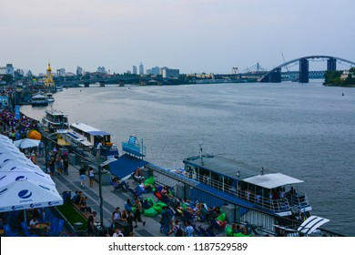 Kyiv, Ukraine - September 1, 2018: Panorama of Kyiv, Ukraine. Dnipro river, Podilsko-Voskresensky Bridge and Kyiv River Port waterfront