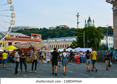 Kyiv, Ukraine - September 1, 2018: Ukrainians and tourists are walking at the festival on Kontraktova Square in Kyiv. Cityscape of Kyiv with Podil historic neighborhood and St. Andrew's church.