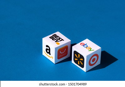 Kyiv, Ukraine - September 10, 2019: A paper cubes with printed logos of eCommerce corporations and online retail stores, such as eBay, AliExpress, Best Buy, Amazon, and others.