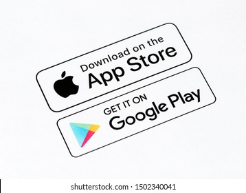 Kyiv, Ukraine - September 12, 2019: Close-up shot of App Store and Google Play download buttons that printed on a white paper.