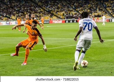 Kyiv, Ukraine - September 14, 2017: Dieumerci Mbokani of Dynamo Kyiv fighting for the ball with Bajram Jashanica of Skenderbeu during UEFA Europa League match at NSC Olimpiyskiy stadium.
