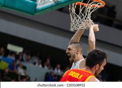 KYIV, UKRAINE - SEPTEMBER 14, 2018: Atlanta Hawks center Oleksiy Alex Len impressive spectacular beautiful finish with slam dunk shot screaming hard.