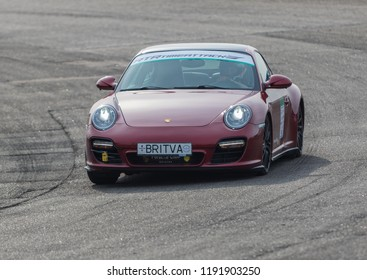 Kyiv, Ukraine - September 15, 2018: race car racing at high speed on speed track at sunny day on a racing track