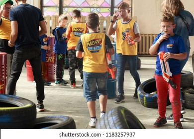 Kyiv, Ukraine - September 16, 2018: Children in T-shirts with the NERF logo   and with NERF gun are preparing for shooting competitions. Selective focus