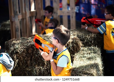 Kyiv, Ukraine - September 16, 2018:    Boys with NERF gun at playground. Nerf Fest