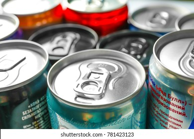 KYIV, UKRAINE - SEPTEMBER 18, 2017: Closed cans with drinks of different popular brands, closeup