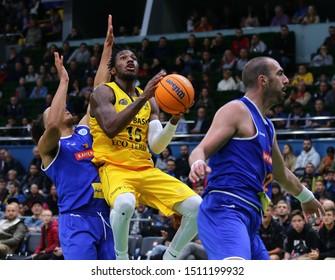 KYIV, UKRAINE - SEPTEMBER 20, 2019: Deon Edwin of BC Kyiv Basket (C) attacks during the FIBA Basketball Champions League Qualifiers game BC Kyiv Basket v Kapfenberg Bulls. BC Kyiv Basket won 73-63