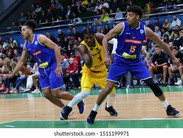 KYIV, UKRAINE - SEPTEMBER 20, 2019: D. Edwin of BC Kyiv Basket (С), K. Nathanial Gumbs and T. Schrittwieser of Kapfenberg Bulls fights for a rebound during their FIBA Basketball Champions League game