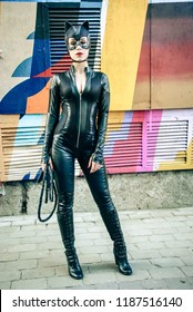 KYIV, UKRAINE – SEPTEMBER 22, 2018: Beautiful young lady dressed as Catwoman during the first Comic Con pop culture festival in Ukraine