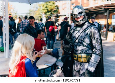 KYIV, UKRAINE - SEPTEMBER 22, 2018: Batman and Supergirl cosplayers posing at Comic Con Ukraine convention at Kyiv or Kiev