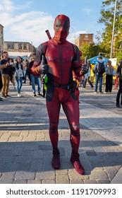 KYIV, UKRAINE - SEPTEMBER 22, 2018: Deadpool cosplayer posing at Comic Con Ukraine convention at Kyiv or Kiev