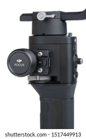 Kyiv, Ukraine - September 28, 2019: Follow focus mechanism on DJI Ronin-SC, Three-Axis Motorized Gimbal Stabilizer for DSLR or Mirrorless Cameras from DJI company, isolated on white background