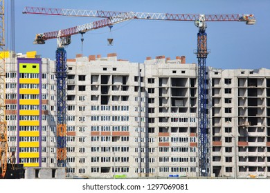 Kyiv, Ukraine - September 3, 2017: The construction of a new multi-storey brick buildings. Building construction site with cranes. The new complex of multi-storey apartment buildings in Kiev region