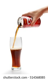 KYIV, UKRAINE - SEPTEMBER 30, 2015. Editorial photo of Sangaria Los Angeles Cola carbonated non-alcoholic drink by Japan Sangaria Beverage Inc. with poured cola in glass isolated on white background.