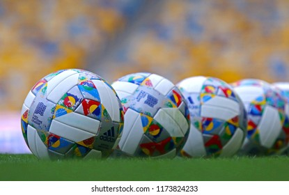 KYIV, UKRAINE - SEPTEMBER 4, 2018: Adidas Nations League, official match balls of UEFA Nations League 2018/2019 on the grass. Ball has colorful design elements inspired by official Nations League flag