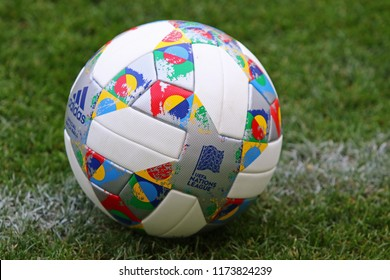 KYIV, UKRAINE - SEPTEMBER 4, 2018: Adidas Nations League, official match ball of UEFA Nations League 2018/2019 on the grass. Ball has colorful design elements inspired by official Nations League flag