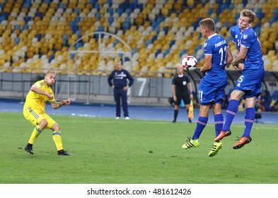 KYIV, UKRAINE - SEPTEMBER 5, 2016: Yaroslav Rakitskiy of Ukraine (L) kicks a ball during FIFA World Cup 2018 qualifying game against Iceland at NSC Olympic stadium in Kyiv, Ukraine
