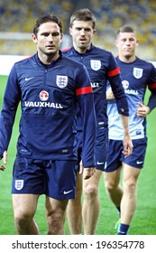 KYIV, UKRAINE - SEPTEMBER 9, 2013: Frank Lampard, Michael Carrick and James Milner of England run during training session at Olympic stadium before FIFA World Cup 2014 qualifier game against Ukraine