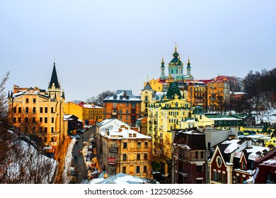 Kyiv, Ukraine. View of Andrew's descent in winter during the cloudy moody day. Snow over the mountain, famous St Andrew church in Kyiv, Ukraine