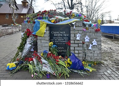 KYIV, UKRAINE-20 FEBRUARY, 2019: Day of memory for Heroes of Heavenly Hundred. Fifth anniversary of perished protesters. Flowers, icon lamps near memorial with mourning inscription and paper angels