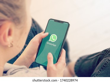 KYIV, UKRAINE-JANUARY, 2020: Whatsapp on Cellphone Screen. Young Girl Pointing or Texting Whatsapp on Smart Phone.