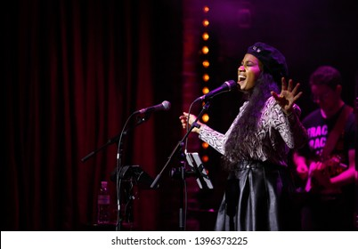KYIV-1 FEBRUARY,2019: Famous r&b singer Mylah performing on stage in night club.Popular African American artist singing live on concert in music hall
