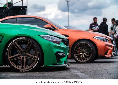 KYIV-15 MAY,2021: Two BMW M3 F80 cars wrapped in chrome and matte vinyls and equipped with wide body kits and custom forged wheels on Drift And Cars Show. Modern German race cars on expo