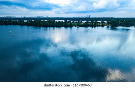 KYIV-22 JULY,2018: Aerial drone photo of beautiful river Dnipro in Obolon district of Kiev city in Ukraine. Blue sky and reflection on water surface at river Dnieper.