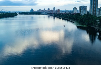 KYIV-22 JULY,2018: Beautiful aerial drone landscape photo of river Dnieper at dusk.DJI quadrocopter camera shoot blue water of river Dnipro from above in Obolon district of Kiev city in Ukraine