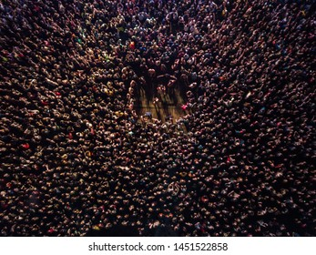 KYIV-25 MAY,2019: Aerial drone photo of huge concert crowd partying to popular edm music on Radio Day Festival outdoor at night.Big group of young people raving to famous dj set