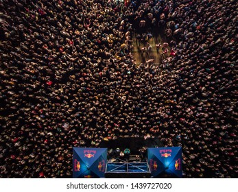 KYIV-25 MAY,2019: Summer music festival crowd partying to famous dj at night.Radio Day Festival event shot from above with aerial drone camera.Popular entertainment event for youth