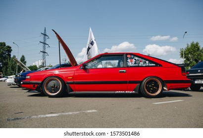 KYIV-28 JULY,2019: JDM car show outdoor.Tuned Japanese drift cars expo in summer.Modified retro Nissan Silvia S12 vehicle with lowered suspension and custom wheels