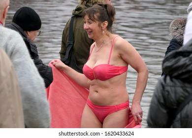 Kyiv/Ukraine, 01/19/2020: Winter bathing in cold river during epyphany celebration